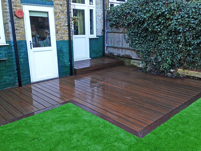 Decking areas artificial grass lawns and turf by carrick for Garden decking and grass